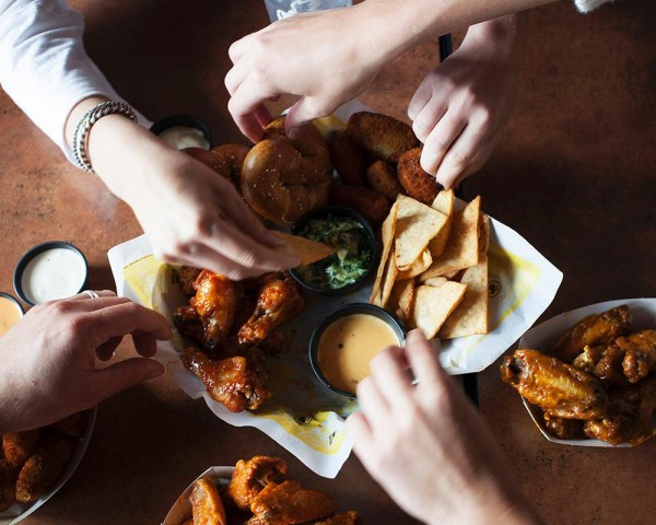 Buffalo Wild Wings serves American bar food with an emphasis on its variety of wing sauces. The restaurant is big, bright and open, a welcome choice when it is crowded with excited sports planetbmxngt.mled Payment: AMEX, Discover, MasterCard, Visa.